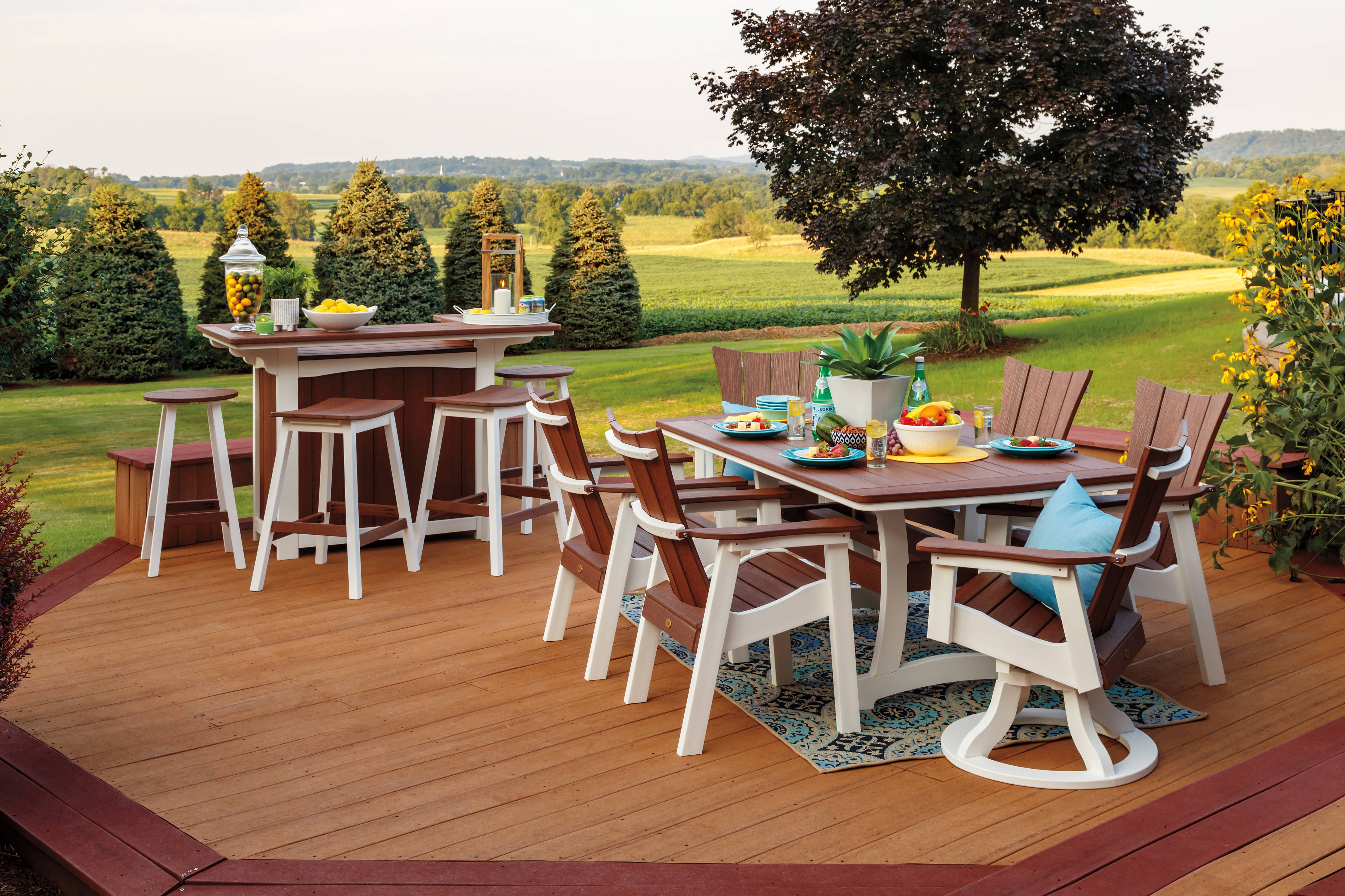 Brown and white poly furniture set on a backyard deck