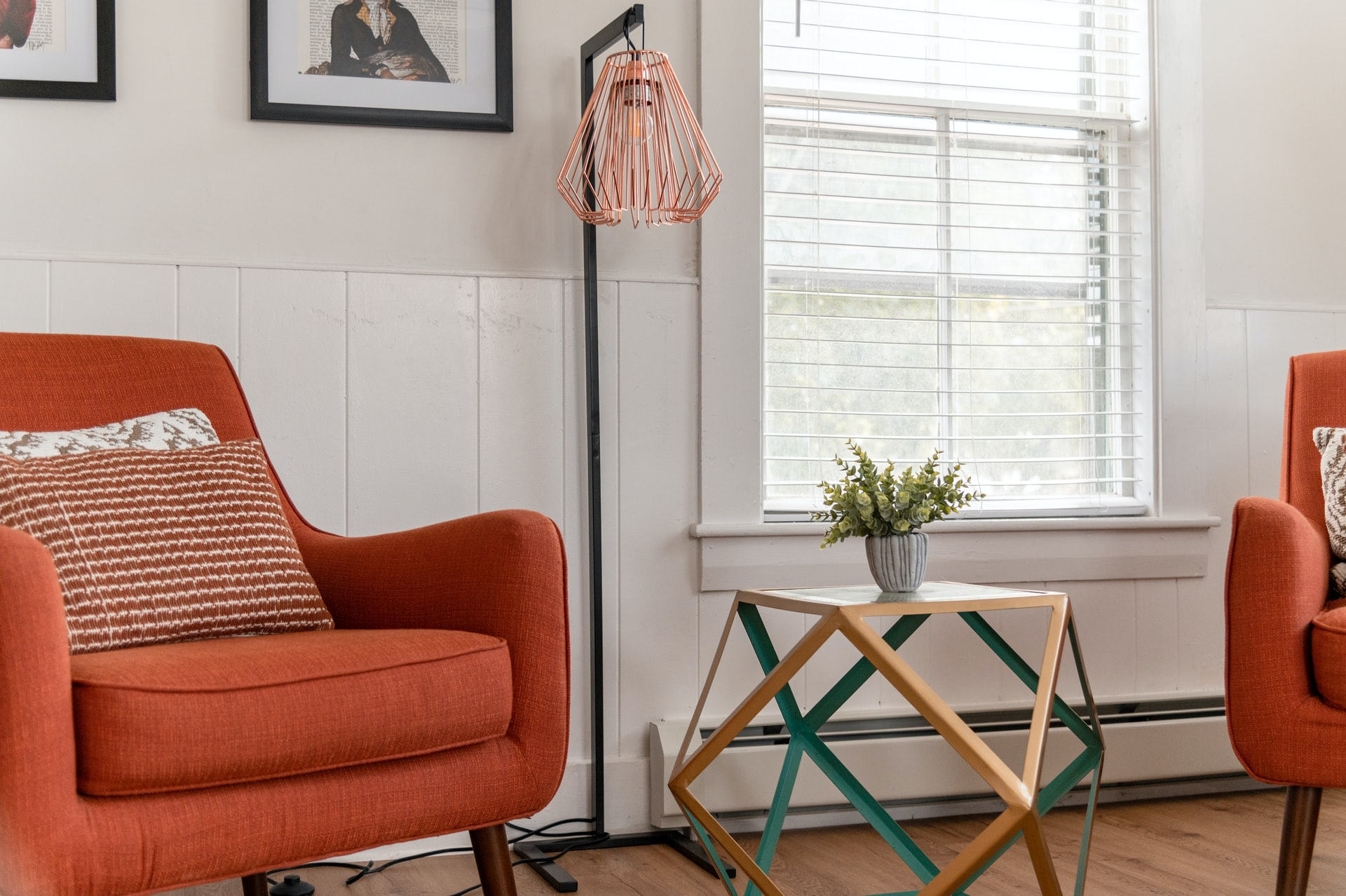 Colorful chair next to green table in a bright room