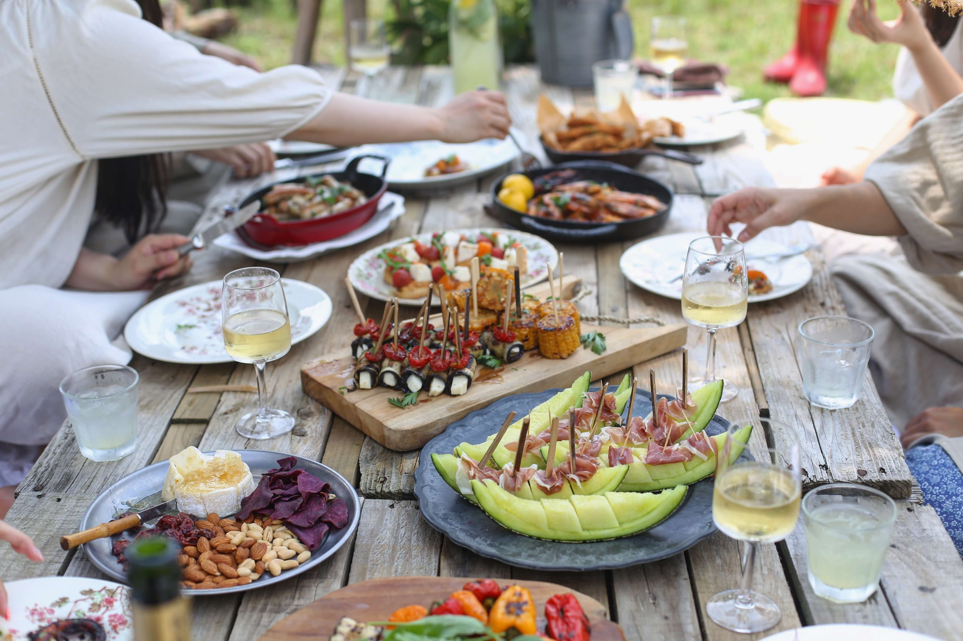 Food and drinks on a wood picnic table